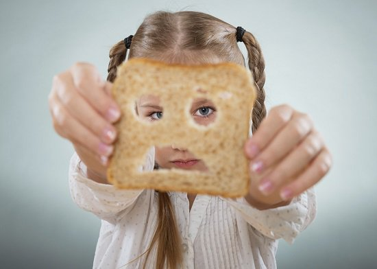 girl-looking-through-a-slice-of-bread